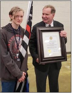 Flag bearer honored in ceremony